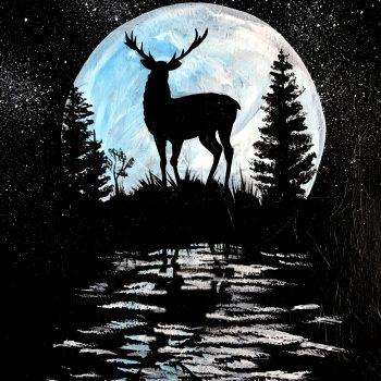 deer silhouetted against moon